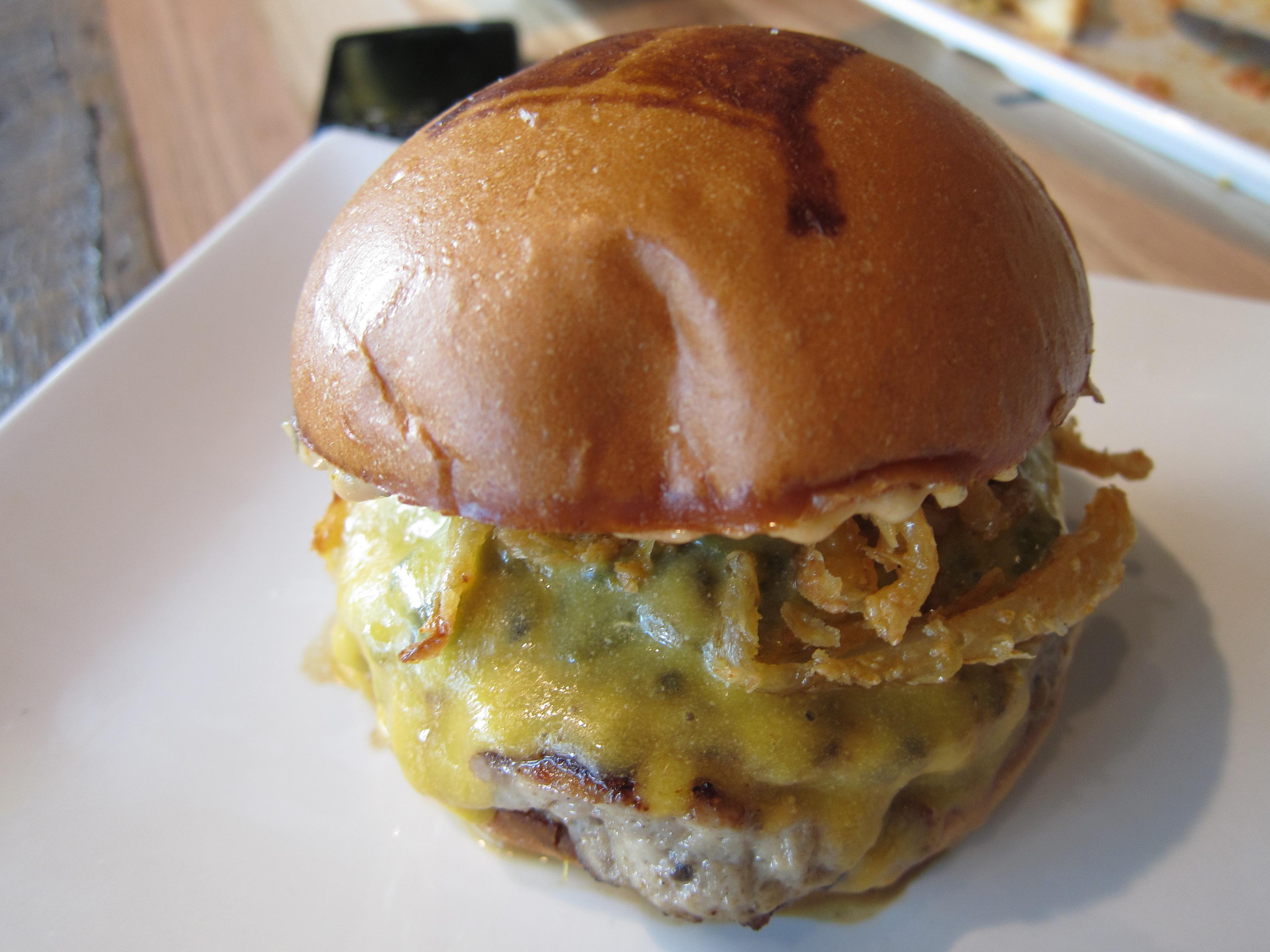Spicy Bird Burger with turkey patty, crispy onion straws, hatch chilis ...