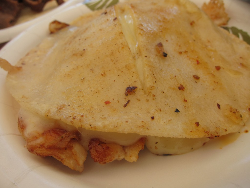 Pechuga Suiza (grilled chicken breast with melted cheese between two corn tortillas)