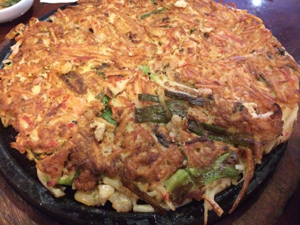 Haemul Pajun (sizzling seafood pancake with scallops, shrimp, oyster, squid, clam and green onion)
