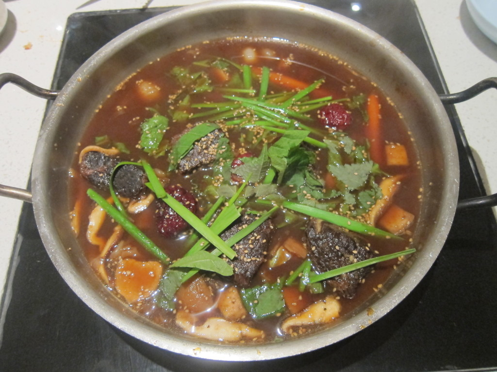 """Shorty"" Hot Pot with Braised Galbi, Chestnuts, Dates, Taro,  Carrots, Turnips, Scallion and Sesame"