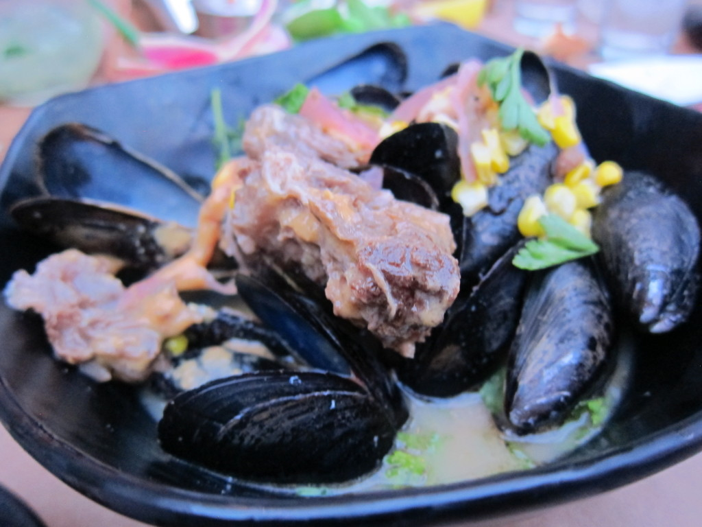 Mussels in Beef Broth with Sweet Corn, Pickled Onions and Oxtail