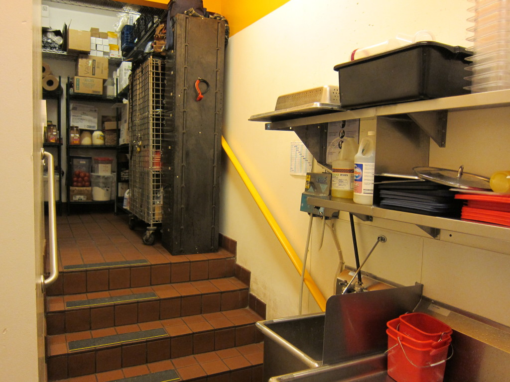Continue through the restaurant's supply closet