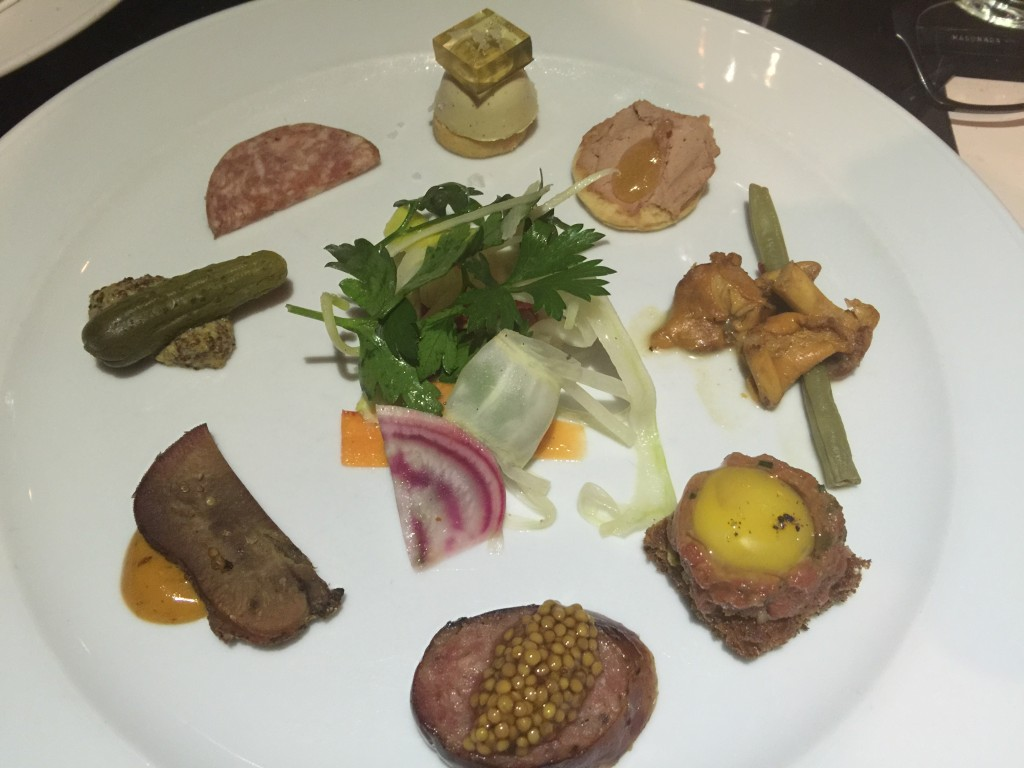 Charcuterie Plate (including Steak Tartare, Quail Egg Toast, Foie Gras Bon Bon, and Beef Tongue Pastrami) from Beast