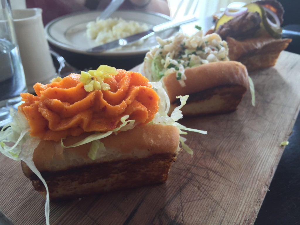 A Trio of Hot Buttered Buns (with Pimento Cheese, Dungeness Crab, and Hot Chicken) from The Woodsman Tavern