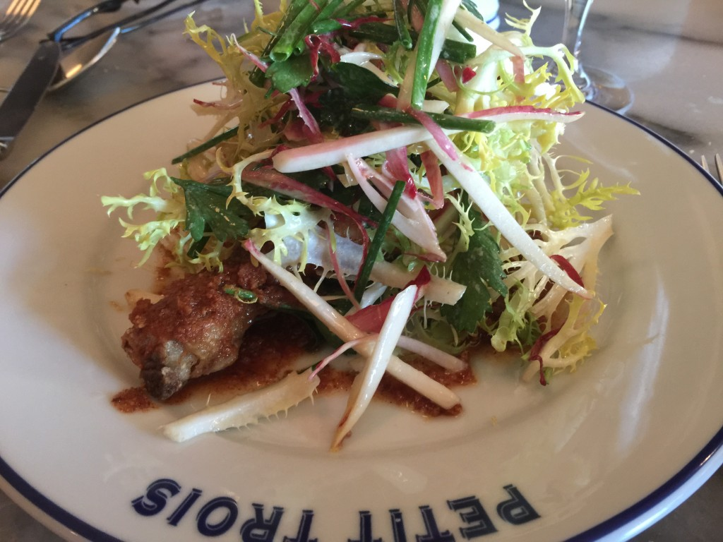 Confit-fried Chicken Leg with brioche butter and frisée salad