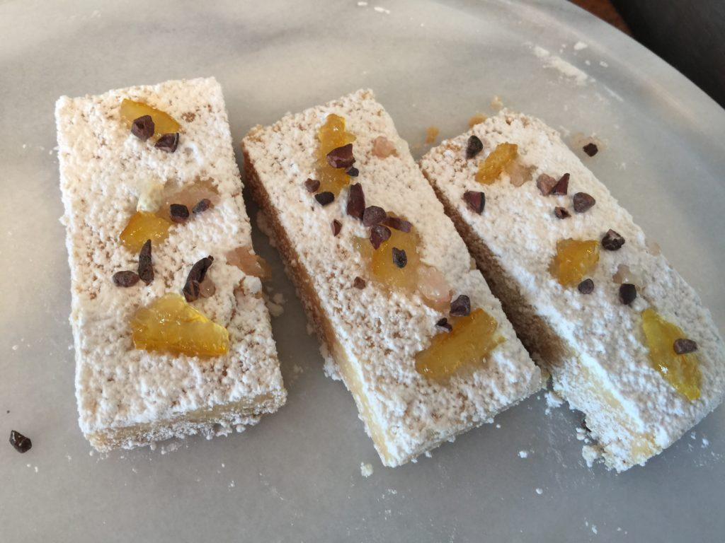 Classic Shortbread with 84% Butter Cacao Nibs, Lemon Compote and Citrus Bursts.