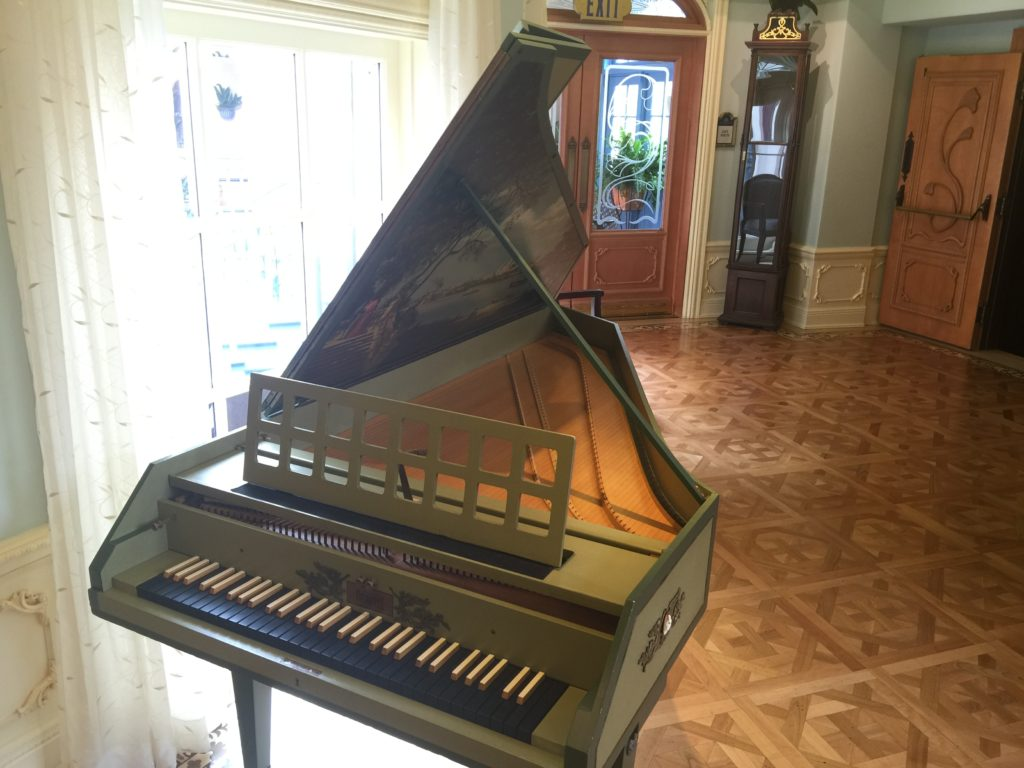 Mrs. Disney's harpsichord in the waiting area