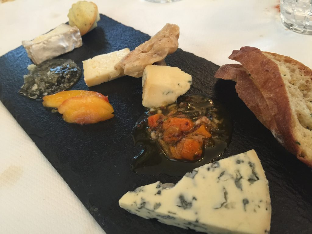 Finely Selected Cheeses with Apricot Mustardo, Pickled White Peach and Lemon-Poppyseed Madeleine