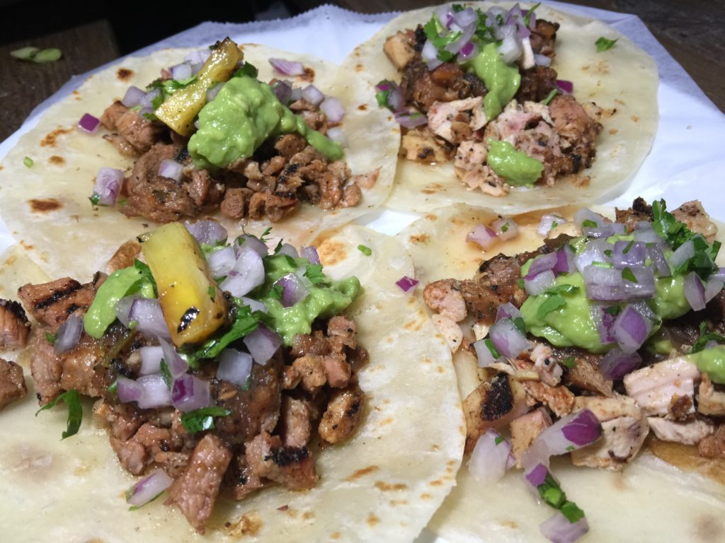 Carne Asada and Pollo Asada Tacos with Avocado, Salsa Vaquera, Cilantro and Onion